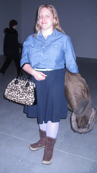 Young Cougar With Bag